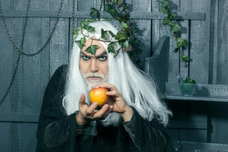 metaphysics: Zeus god or jupiter with enchanted apple in studio