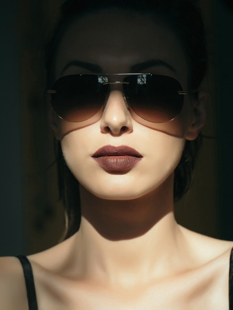sexi: young cute sexy woman or girl portrait with brown lips on pretty face has fashionable makeup in sunglasses sunny day Stock Photo