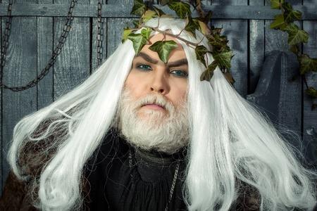 Zeus god or jupiter with vine crown in studio Stock Photo