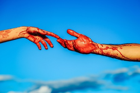 zombie hands male and female of man war soldier and girl woman with bloody wounds and red blood on skin on blue sky background