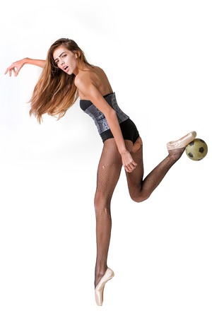 ballerina tights: Pretty sexy girl football player cute slim woman ballerina with long hair and legs in fishnet tights pointe shoes and fashionable leather body suit with ball isolated on white background