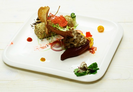 Delicious snack of whipped puree or paste on red beet and roll with sesame seeds with wheat and brown toast bread on plate on white background. Modern molecular gastronomy Stok Fotoğraf