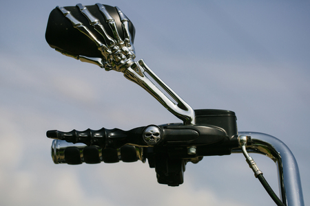 metallized: Motorbike handlebar with the mirror in skeleton design chrome metallized color on sky background Stock Photo