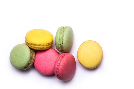 colorful macaron, tasty cookies, biscuits or meringue pastry pink, green, yellow color with calorie isolated on white background, copy space