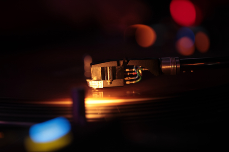 old school music, technology and progress, music and entertainment, party and holidays, bokeh or blurred background, back to basics, selective focus, controls detail Stock Photo