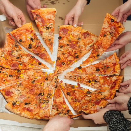 Pizza. Human hands taking big, cooked, fat, tasty italian pizza, fast food, slices from box package. Delivery menu