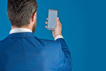 business office man or young businessman with mobile phone, copy space Stock Photo