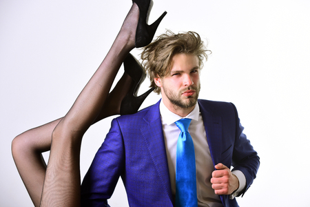 businessman in suit and female sexy legs in fashionable shoes and tights isolated on white background, love and relations, power, boss, office romance, sexual services, couple in love Stock fotó