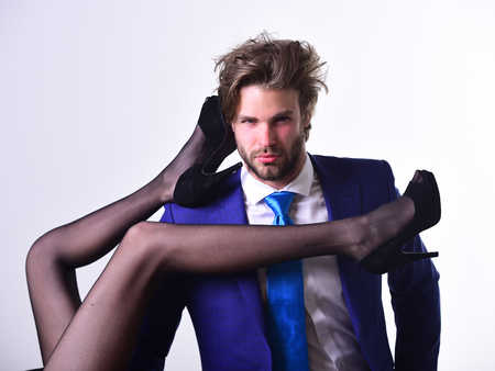 sexy legs of woman body and man in suit, shoe style, isolated on white background, infidelity and punishment Фото со стока