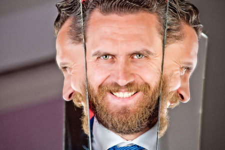 happy face of bearded hipster man or businessman reflecting in mirror, multifaceted business, agile business, success and vision, barbershop and hair