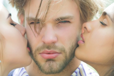 kiss of couple in love of woman and girl to man