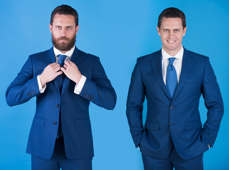 man or businessman with different emotions in business suit and tie on blue background. Confident, serious, bearded face with beard on left and happy, smiling, shaven on right. Contrast