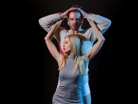 couple. couple in love, woman with pink lips, manicure and blonde hair embracing young man on black background Zdjęcie Seryjne - 80166554