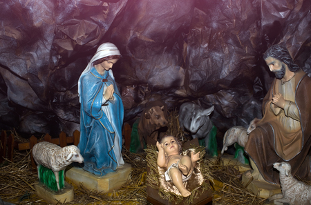 christmas manger scene with figurines including jesus mary sheep and magi stock photo
