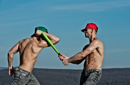rowdy: young people of men with baseball bat in hand on sky background, spring and summer nature, energy