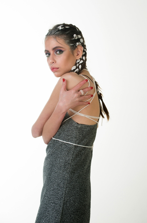 girl or pretty woman, young, fashionable model with stylish hair, braids, color makeup and red fingernails wearing grey dress isolated on white. Fashion, beauty, manicure. Hairdressing salon