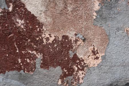 壁、古い灰色、茶色、ラフ、漆喰、セメント、コンクリート背景に欠け塗料のテクスチャー サーフェス。建築・建設。損傷、崩壊と破滅