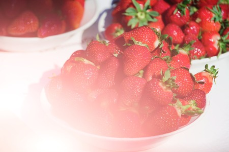 fresh red strawberry in plates on table, summer harvest, fruit and vitamin, healthy eating and dieting