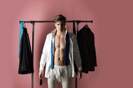 guy with shaved face has muscular torso in white shirt and tie, hold hair brush on pink background, hairdresser and barbershop Reklamní fotografie - 80239025
