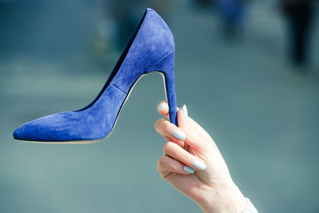 glamour shoe blue color suede on female hand on blurred background, fashion and beauty, shopping and presentation, cinderella