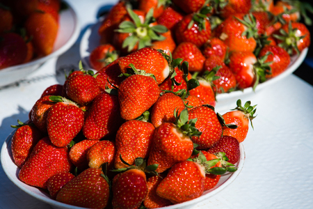 strawberry in plates on table, summer harvest, fruit and vitamin, healthy eating and dieting