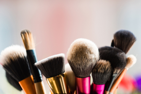 make up. brush for fashionable makeup or cosmetic on blurred background, fashion and beauty, visage and design Banco de Imagens