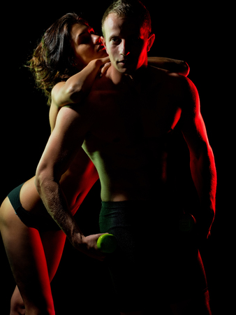 sport. sexy man with muscular body and torso hold dumbbell or barbell in athletic hands and girl, couple in love, health and fitness, foreplay, seduction, tenderness and affection, bisexual, workout
