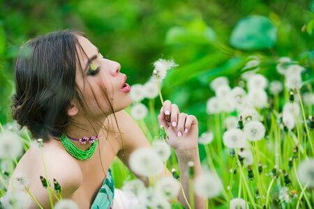 visage: girl. woman with fashionable makeup and beads in green leaves and flower on natural background, beauty and fashion, youth and freshness
