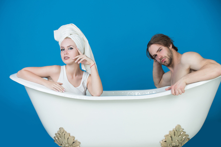 young beautiful couple in love sitting on bath, man and woman