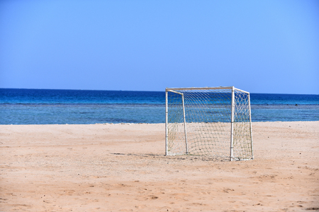 Goalpost on beach for playing football for summer sport on background of blue sea and sky, copy space Stock Photo