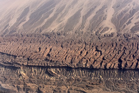 Desert. Beautiful aerial landscape of brown bachans and dunas from airplane flight, geology and environment 版權商用圖片