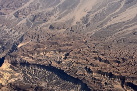Desert view with rugged barren terrain beautiful geographic landscape with hilly areas from airplane Imagens
