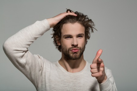 hair and beard of man in white underwear on grey background, morning and fashion, barbershop