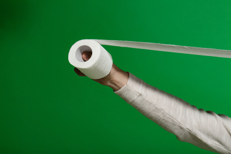 hand hold toilet paper. Hygiene and sanitary. WC and restroom. Sterility and purity, copy space Stock Photo