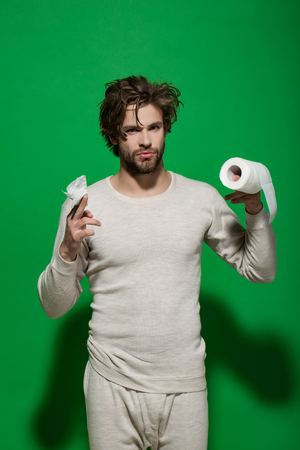 Guy in underwear in morning. Hygiene and sanitary. WC and restroom. Sterility and purity. Man with serious face hold toilet paper. Stock Photo