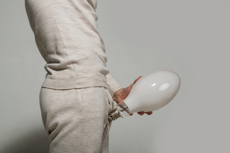 Man with big lamp near pants. handjob and masturbations. Energy and electricity concept. Power and business success. health and enlargement.