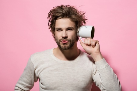 overhear with cup of man in morning on pink background