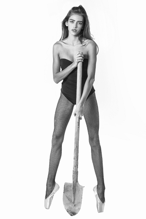 woman or ballerina in ballet shoes with shovel, black and white Stock Photo - 82775864