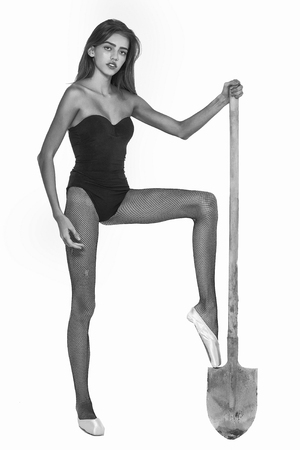 builder or woman or ballerina in ballet shoes with shovel, black and white Stock Photo
