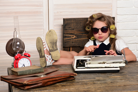 Education and childhood. Kid choose career in glasses. Small girl with curler in hair. Child with briefcase and alarm clock. Little baby secretary.