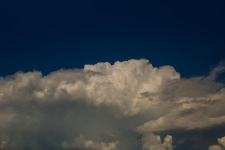 White clouds on blue sky. Cloudscape on idyllic sunny day. Skyline with cloudy background. Heavens and holy spirit. Weather and climate concept, copy space.