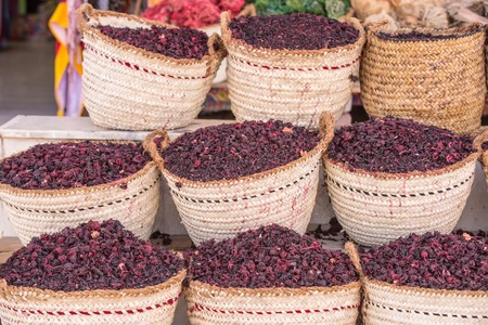 Hibiscus dry herb in sale. Hibiscus lilac flowers in baskets. Natural organic herbs. Condiment and ingredient concept. Arabic herbs on traditional bazaar.