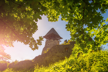 Protection and defense concept. Bastion on sunny summer day. Castle tower and wall. Landmark and travel destination. Stone fortification on green hill on blue sky. Reklamní fotografie - 85839760