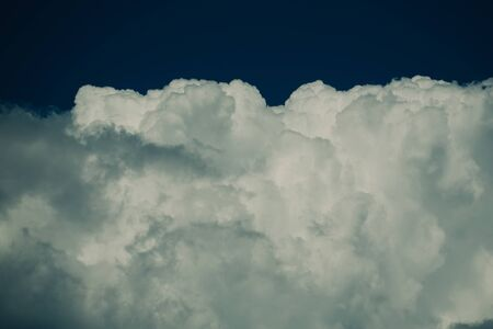 Weather and climate concept, copy space. Skyline with cloudy background. White clouds on blue sky. Heavens and holy spirit. Cloudscape on idyllic sunny day. Imagens