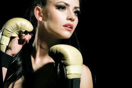 Coach and health. Workout of girl boxer on black background. Power and energy. Sport and success. Woman in boxing gloves and sportswear.