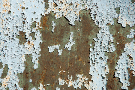 Plate surface with rusty metal texture and old grey paint cracking and peeling on rusted metallized background. Neglect, decay and ruin concept
