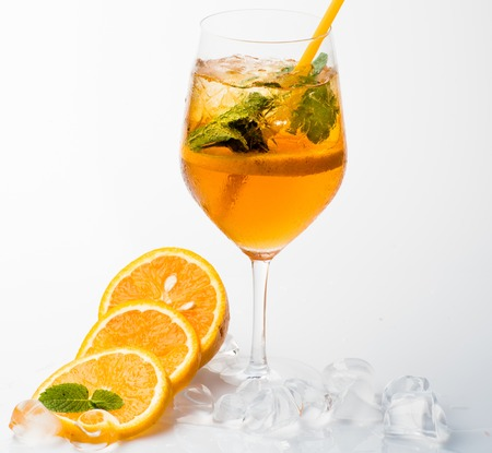 Alcoholic beverage and lemon fruit at restaurant. Cocktail isolated on white background. Drink and food. Fruit slice and cocktail glass at bar. Party and summer vacation.