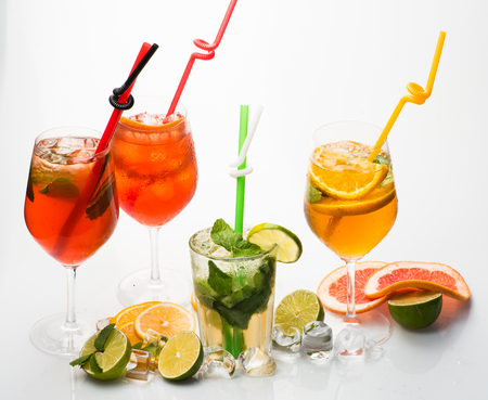 Cocktails isolated on white background with mojito. Party and summer vacation. Alcoholic beverage and fruit at restaurant. Fruit slice and cocktail glass at bar. Drink and food.
