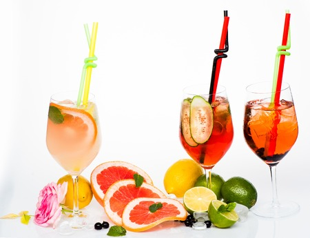 Drink and food. Alcoholic beverage and fruit at restaurant. Party and summer vacation. Fruit slice and cocktail glass at bar. Cocktails isolated on white.