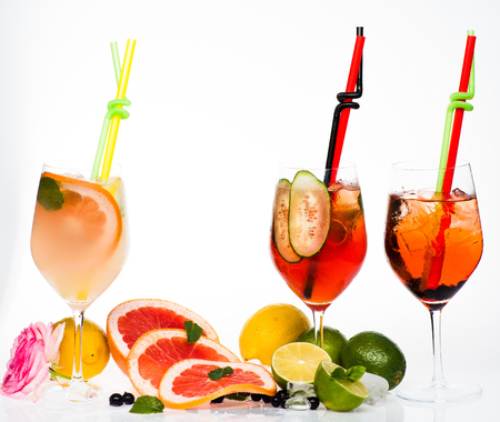 Drink and food. Fruit slice and cocktail glass at bar. Alcoholic beverage and fruit at restaurant. Party and summer vacation. Cocktails isolated on white. Stock Photo